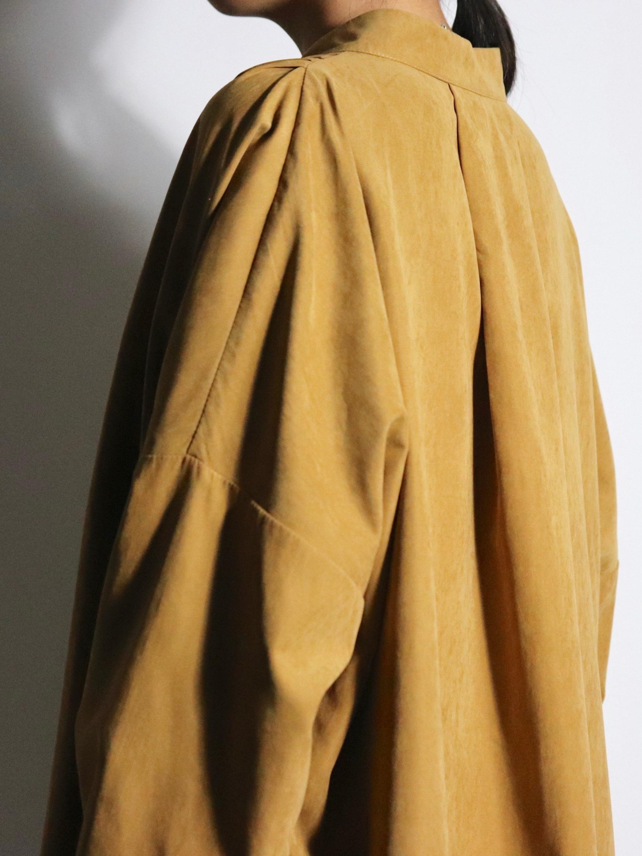 Peach skin over coat