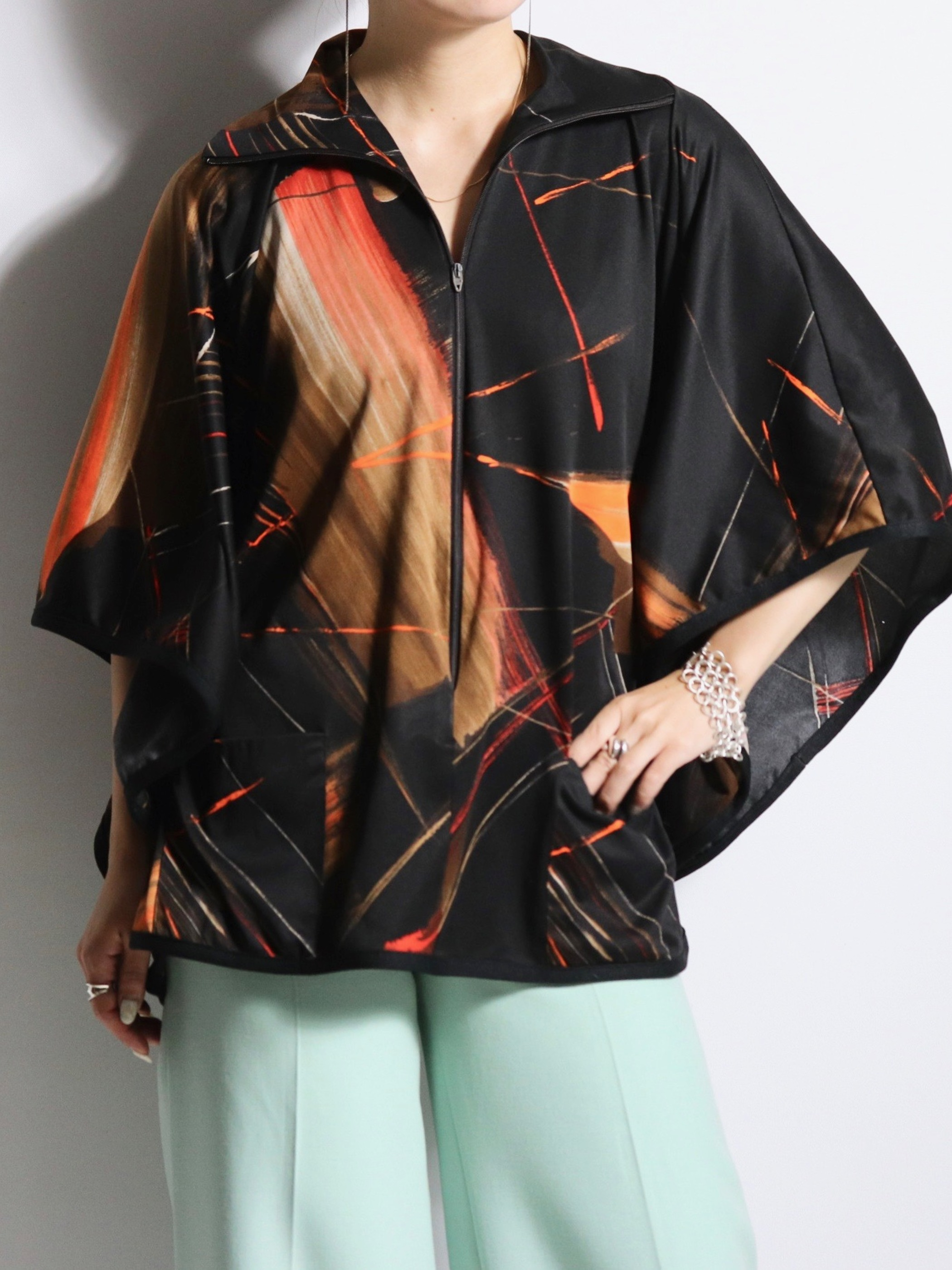 Design zip-up poncho